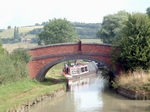 Trad boat firmly aground at next 			lock