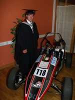 Matt, alongside the car they built, at the graduation.